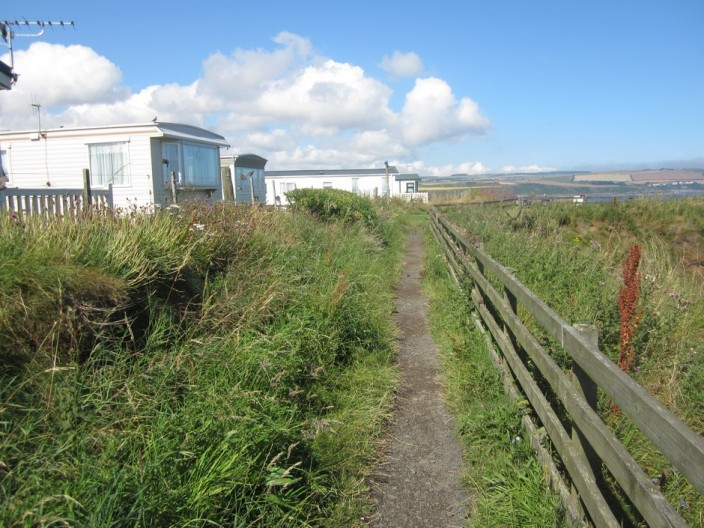 footpath between the cliff and caravans at Eyemouth