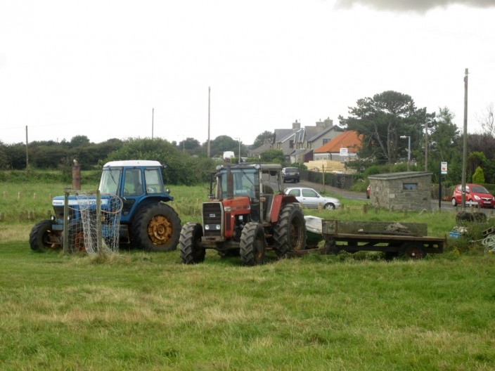 A pair of tractors and trailers at Boulmer
