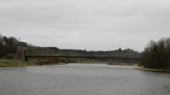 The Union Chain Bridge across the river
